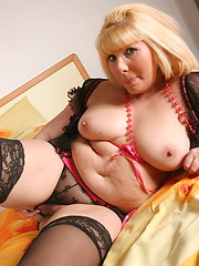 Horny blond woman dressed in sexy lingerie