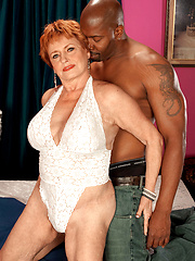 Redhead mature woman likes black tool